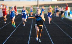 Northeast's Danae Diedrich leaves her competition in a blur as she finishes the Rebels' 400-meter relay victory Thursday at the Big East Conference track and field meet in Goose Lake.  / Clinton Herald