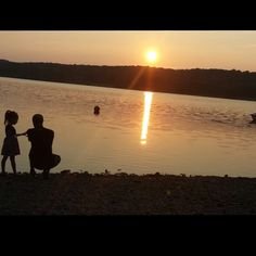 """A father and daughter looking out at Peace Valley Lake near Doylestown, silhouetted in a beautiful summer sunset captured by @philly_instructor on Instagram as part of our 2014 """"Capture Your #BucksCountyMoment Photo + Video Challenge."""""""
