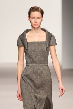 Nice collar style, but closer in to neck with two rows of buttons on the centre panel of the dress.