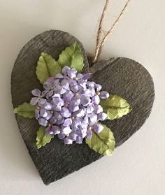 Our design team member Selma created this gorgeous Hydrangea from Susan's Garden Club new die set. Els Van de Burgt added the prills to the flower center and mounted the gorgeous flower on a cute wooden heart! This would be the perfect window ornament to help decorate for spring! Inspiration is all around us! Shop the supplies: https://www.elizabethcraftdesigns.com/.