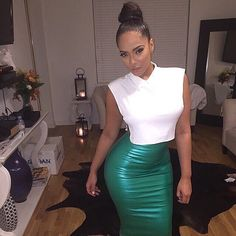 Symmetric white top and teal Lycra skirt