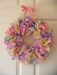 Beautiful and whimsical, handmade shabby chic fabric wreath.... so pretty! Such a unique way to brighten up a nursery or bedroom door.    I