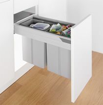 Guide to In-Cupboard Bins -- Integrated kitchen bins are a great way to use your space and keep your kitchen looking sleek by creating a hidden bin from one of your cabinets. They fix to the base or sides of your unit and when the cupboard door is closed your recycling and waste are kept out of sight. This is guide to help you narrow down first your door type and then cabinet width, giving you product options to click through to the detailed product page.