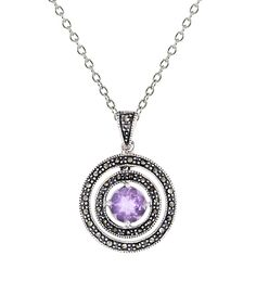 Ken Craft Marcasite & Lavender Cubic Zirconia Round Pendant Necklace | zulily  . $19.99 Compare at $40.00 Product Description:  Suspended on a slender chain, a lustrous sterling silver pendant covered in glittering marcasite and cubic zirconia highlights your collarbone with ethereal shine.      Chain: 16'' L with 2'' extender     Pendant: 0.85'' W x 1.25'' L     Lobster claw clasp     Sterling silver / marcasite / cubic zirconia     Imported