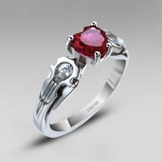 """Unique design""? That's a Horde ring if I ever saw one!  --925 Sterling Silver Heart Cut Lab-created Ruby Women's Ring in Unique Design"