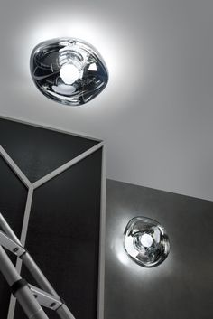 Squashed, squeezed, distorted and moulded into a flatter blob, Melt's extraordinary luminosity has found new applications on wall, ceiling or floor.  https://www.tomdixon.net/melt-surface-light-chrome-ip44.html  This new metallic lighting design variation by Tom Dixon would possibly work well with subtle greys and navy and softer Scandinavian accents. What do you think?
