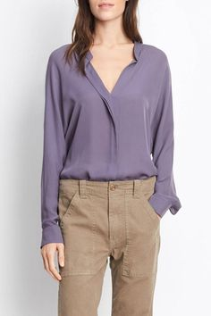 This long sleeved blouse features a split v-neckline, button front styling with a covered placket, drop shoulders and inverted pleat detailing in back. Fit: This top has an oversized fit. Care: Dry clean   Double Front Blouse by Vince. Clothing - Tops - Long Sleeve Greenville, South Carolina