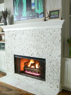 Fireplace with stacked stone veneer that doesn't go up to ceiling and floating mantle