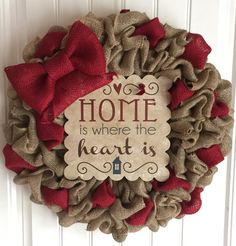 This beautiful wreath measures 23 x 23 x 4. It is made with natural burlap and has red burlap added in different places. Thin sign that says