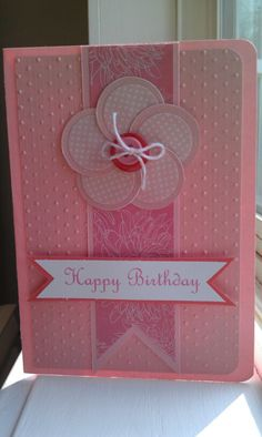 Pink flower card made with circles.