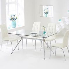 Sleek and minimalist, this Mark Harris dining table makes an elegantly contemporary impression in your dining area. Visually appealing, this contemporary glass dining table is ideal for any modern dining space. Check it out on our online store :point_righ
