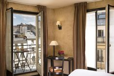 Hotel Europe Saint Severin Left bank: The Tradition Room with Balcony, 12m², are all facing the street and are located on the second and the fifth floor of the builiding. A table with two chairs on the balcony allows you to enjoy the