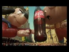 Macy's Thanksgiving Day Parade balloons vie for a Coke bottle balloon during an aerial tussle in the skies of NYC.