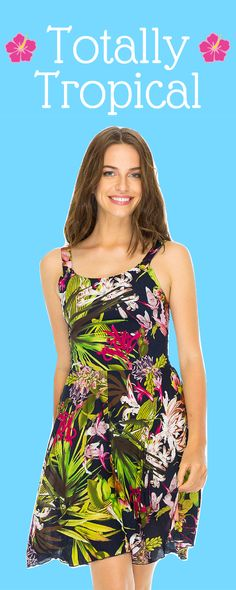 Are you ready for summer parties? This tropical fit and flare dress can be worn three ways; as a tank, halter or crisscross style. The perfect floral dress for any summer occasion.
