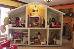 Talk about an American Girl doll house! This one has lights and everything!