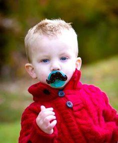 moustache pacifiers! hahaha LOVE