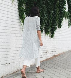 Long top with cropped pants.