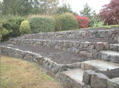 We want our front yard to look like this (garden and rock tiers only). Again, no lawn to mow.                                                                                                                                                                                 Más