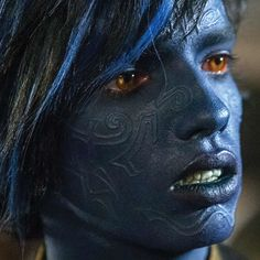 """MAKEUP: """"In the comics, Nightcrawler is always portrayed as a dark silhouette with this long, cat-like tail, crouching down in a very large, cat-like manner,"""" says Special Effects Makeup Department Head Adrien Morot, who conjured a new and youthful feline aesthetic for beloved blue Marvel character Nightcrawler. Find out how he and Makeup Department Head Rita Ciccozzi transformed a cast of hundreds in the magical mutant epic X-Men: Apocalypse, only in the latest M·A·C Movie Makeup!"""