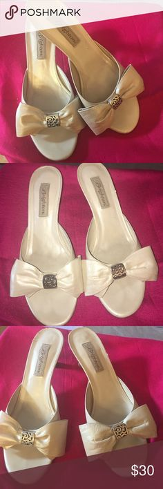 Brighton ivory bow sandals size 8 Brighton ivory bow sandals size 8.  Gorgeous sandals.  In great condition with only some wear showing in the back of the leather heel of one of them. - see photo. Otherwise in very good condition with soft ivory leather. Brighton Shoes Sandals