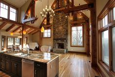 Great Room, Family Room, Post and Beam, Custom Home, Plank Wood Flooring, Kitchen, Open Floor Plan, Stone Fireplace, Custom Lighting, Stained Interior Trim, Built by Foreman Builders