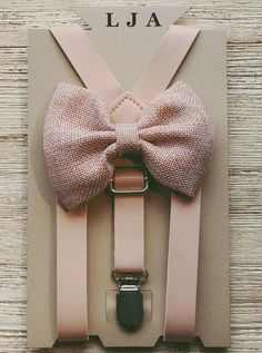 This skinny blush pink faux leather adjustable suspenders with blush pink bow tie set is perfect for your groomsmen, ring bearers, family photos or just because! **Suspenders and bow ties can be purchased individually in the same drop down menu** Pink Groomsmen, Groomsmen Suspenders, Groomsmen Outfits, Suspenders For Boys, Leather Suspenders, Wedding Suspenders, Ring Bearer Suspenders, Pink Bow Tie, Burlap Bows