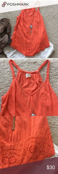 "{Anthropologie} Knotted Lace Tank {Anthropologie} Knotted Lace Tank by Meadow Rue. Super cute and comfy 100% cotton tank. Eyelet detail around the bottom. Gorgeous coral/orange color. Laying flat approx 27.5"" shoulder to hem, approx 15.5"" pit to pit. Size S. Excellent condition. Anthropologie Tops Tank Tops"