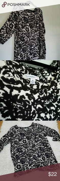 ISAAC MIZRAHI LIVE BLOUSE Like new, Isaac Mizrahi live black and white floral, 3/4 sleeve blouse. Size XL 95% rayon and 5% soandex. Very lightweight blouse. Very flattering. Isaac Mizrahi Tops Blouses