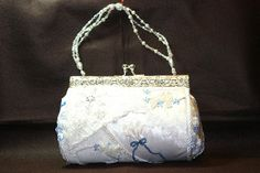 Made by my VERY talented sister!  Brides purse made for my neice's winter wedding