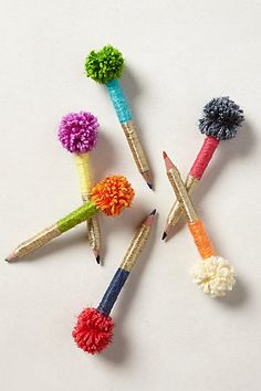 Obviously, I want to DIY these. Pom-Pom Pencils   #anthropologie