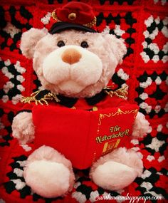 Nutcracker Teddie from Cuddle Barn - he gives almost FOUR full minutes of story telling and songs. Moves his head and mouth. Uh-DOOR-able.