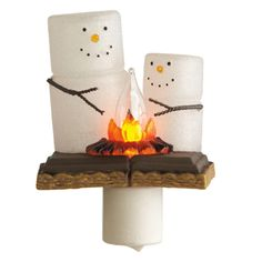 S'mores Family Flicker Night Light -how cute. Love making s'mores over a campfire on a summer night - well, spring and fall for that matter too.
