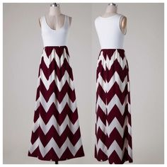 New! Chevron burgundy and white maxi dress New!! Burgundy and White chevron dress. Has a sleeveless  jersey top and a high waist chevron printed woven bottom Maxi style dress with semi lining.  100% Polyester Made in USA Maturally Spiritual Boutique Dresses Maxi