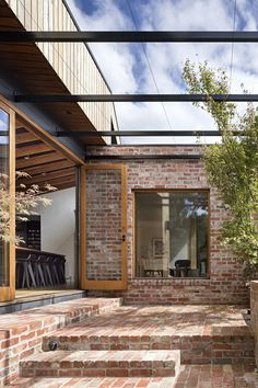 Outdoor and Small Patio, Porch, Deck A steel pergola creates an outdoor living space; in the summer, grape vines climb up to create a lush canopy. klinkerhaus Photo 7 of 13 in Chef Scott Pickett's Renovated Bungalow Stars a… Steel Pergola, Pergola Patio, Backyard, Pergola Ideas, Patio Ideas, Pavers Patio, Wisteria Pergola, Black Pergola, Firepit Ideas