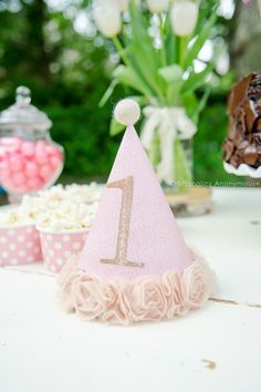 1st birthday Party hat with felt ball top and gold glitter number. Love the rosette trim around the bottom!