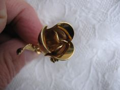 'Gold tone Rose Of Love Brooch' is going up for auction at  7pm Sun, Oct 21 with a starting bid of $6.
