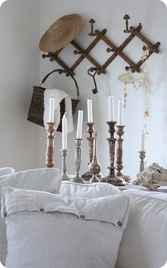 love the grouping of tarnished silver candlesticks Wood Basket, Silver Candlesticks, Little Corner, Tarnished Silver, Displaying Collections, Candle Lanterns, Ideal Home, Decoration, Light In The Dark