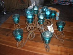 Candelabra/chandelier made from old glass insulators! I have a whole box full of these just waiting to be turned into something!
