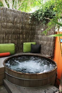 ideal hot tub. replace the tiki wall with something more rustic - river stones, logs. and we've got an oasis.