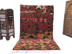 Beniouarain Carpet is the home of handmade imported carpets and rugs from Morocco. With all the carpets, area rugs, pillows and additional nomad treasures that we carry, let our home reflect the look of your home. Berber Rug, Floor Chair, Rugs On Carpet, Hand Weaving, Area Rugs, Pillows, Interior, Furniture, Moroccan