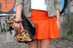Bright orange mini, leopard clutch & pink nails