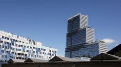 Le futur palais de Justice de Paris (droite) et le bâtiment de la nouvelle direction régionale de la police judiciaire (gauche). | LUDOVIC MARIN / AFP