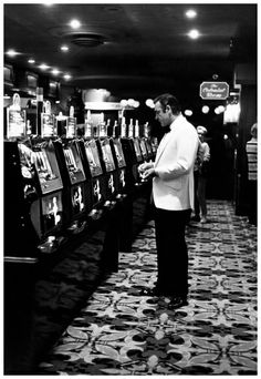 """Photo Terry O'Neill   Sean Connery as James Bond,  Las Vegas, tries his luck on the set of Diamonds Are Forever """"Lucky 007, 1971"""