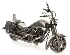 A one of a kind piece that any art or car lover will go crazy for!! Nicks. Dings. Scratches. Burns. A cool motorbike from several auto parts and scrap metal. Mastering the art of recycling metal, Buil