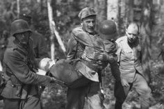 Finnish soldiers evacuate wounded man,1944 - pin by Paolo Marzioli