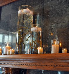 Curly willow branches submerged in water for floating candles.  Love this look!
