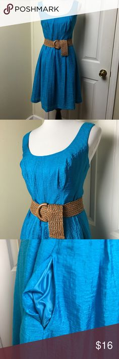 Nine West sleeveless dress Nine West sleeveless dress. Scoop neck and side pockets.  Belted waist or can be worn loose without belt. Belt buckle is broken, however belt can be replaced using most any wide belt. Priced accordingly. Nine West Dresses