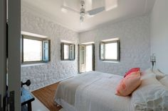 Greg Haji Joannides used historic photographs as a guide when creating a new contemporary interior for this earthquake-damaged house on the Greek island of Nisyros Island Villa, Interior Architecture, Interior Design, Interior Ideas, Two Storey House, Hotels, Village Houses, Luxurious Bedrooms, Historic Homes