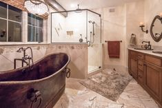 The Master Bathroom in our Ironwood plan is a personal retreat. Visit to see more of this post and bean home. #barnhomes