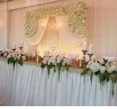 Large Ivory Flower Arch Wall with a chandelier and White Draping Now Available @idesignevents